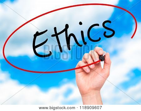 Man Hand Writing Ethics On Visual Screen
