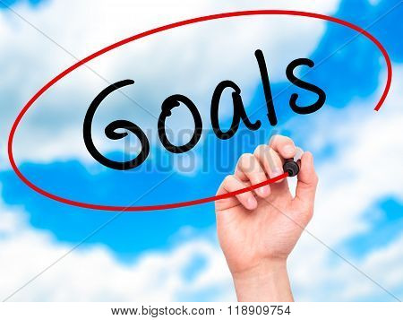 Man Hand Writing Goals On Visual Screen