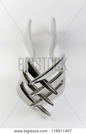 Praying Metal Forks.