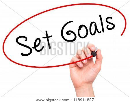 Man Hand Writing Set Goals On Visual Screen