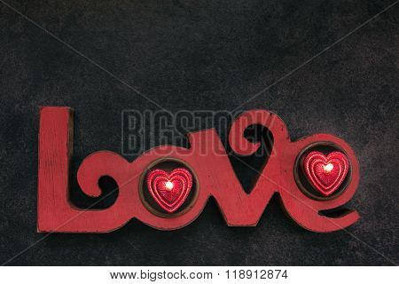Word Love, With Two Small Red Candle, Top View
