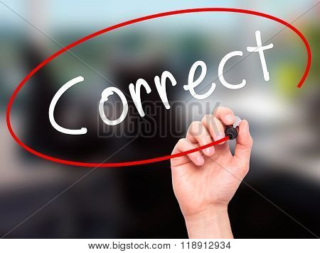 Man Hand Writing Correct With Black Marker On Visual Screen