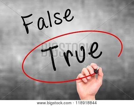 Man Hand Writing An Choosing True Instead Of False With Black Marker On Visual Screen