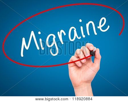 Man Hand Writing Migraine With Black Marker On Visual Screen