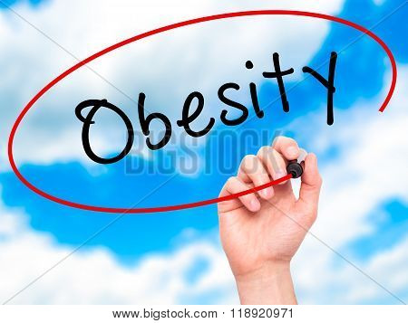 Man Hand Writing Obesity With Black Marker On Visual Screen