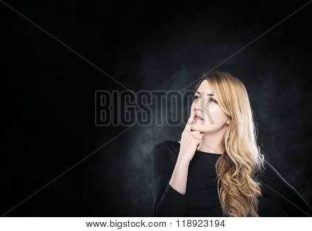 Blond woman pondering over something.