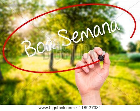 Man Hand Writing Boa Semana (good Week In Portuguese) With Black Marker On Visual Screen