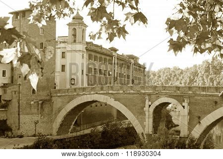 The Tiber Island And The Bridge Over The Tiber River - Rome - Italy