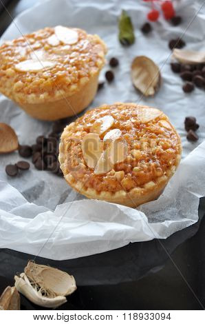 Two Almonds Sweet Tart On Crumpled Paper