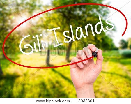 Man Hand Writing Gili Islands With Black Marker On Visual Screen