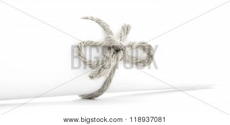 Handmade natural rope node tied on white letter package isolated
