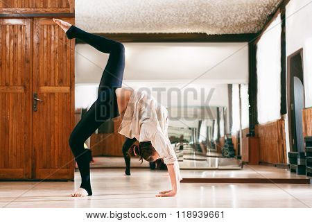 young woman trains the flexibility