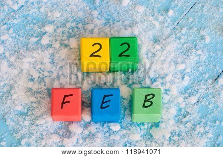 February 22nd. Calendar date on color wooden cubes with marked Date 22 of february. Winter end conce
