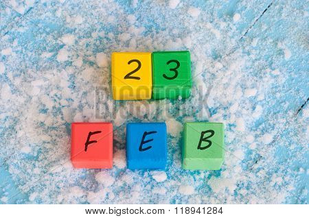 February 23rd. Calendar date on color wooden cubes with marked Date 23 of february. Winter end conce