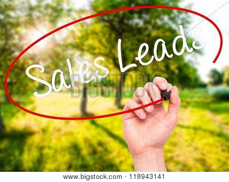 Man Hand Writing Sales Leads With Black Marker On Visual Screen
