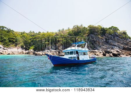 Cruise boat with tourists off the island in the Andaman Sea, coast Thailand