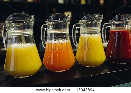 colored juices in carafes