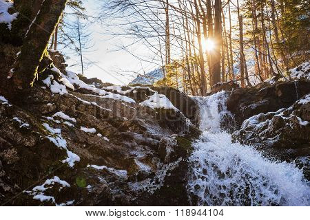 Cold Mountain Brook With Cascades And Bright Sunshine
