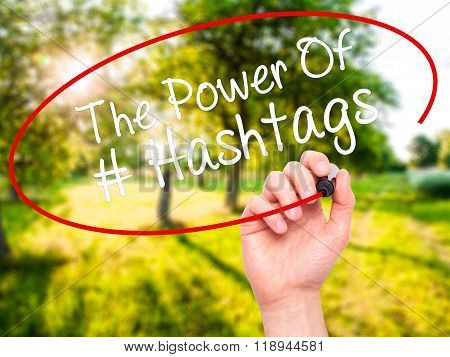 Man Hand Writing The Power Of Hashtags With Black Marker On Visual Screen