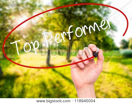 Man Hand Writing Top Performers With Black Marker On Visual Screen