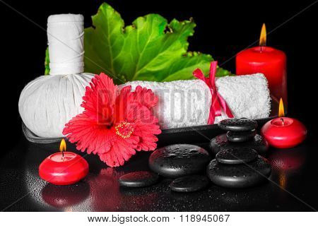 Spa Concept Of Red Hibiscus Flower With Dew, Candles, Leaf, Thai Herbal Compress Ball And Rolled Tow