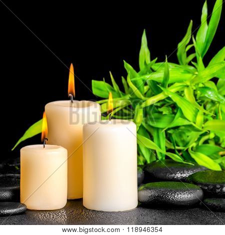 Spa Composition Of Twigs Bamboo With Dew And Candles On Zen Basalt Stones, Closeup