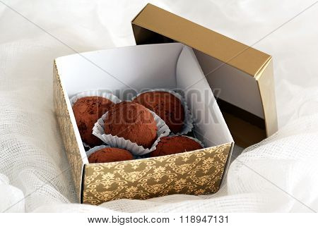 box of chocolates and truffles in chocolate prunes