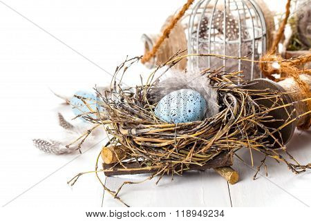 Easter Eggs Nest With Birdcage, On White Wooden Background