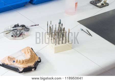Dental Burs And Dental Articulator In A Lab.