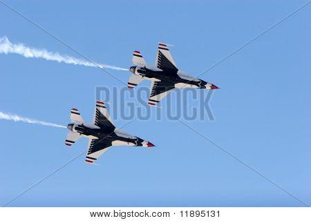 F-16 Thunderbird jets leaving smoke trails