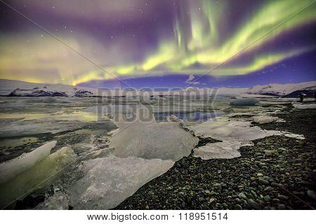 Auroral Over The Glacier Lagoon Jokulsarlon In Iceland.
