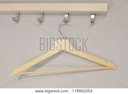 Wood Coat Hanger Hanging On A Clothes Rack