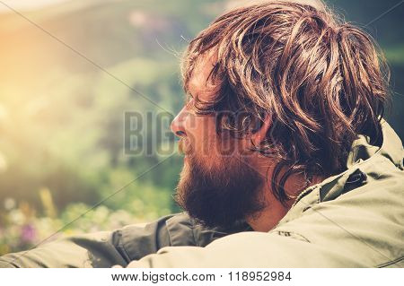 Young Man bearded relaxing alone outdoor Travel Lifestyle