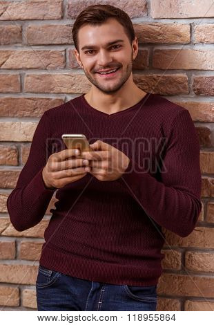 Attractive Businessman With Gadget