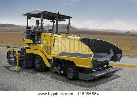 Asphalt Spreader Machine On The Road