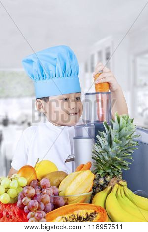 Child Making Juice Of Carrot And Fruits