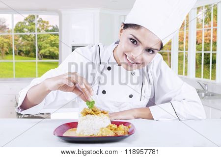 Female Chef Garnishing Food