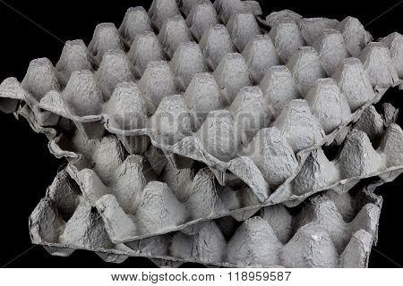 Egg Trays On A Black Background