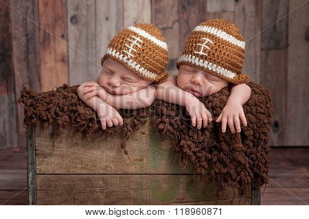 Twin Baby Boys Wearing Football Shaped Hats