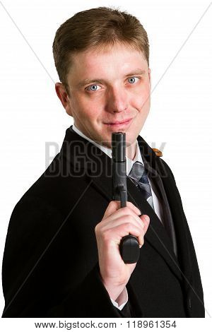 The Man In A Suit Aims From A Pistol.