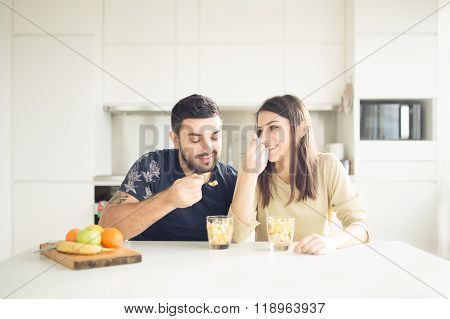 Young lovely couple eating fruit salad healthy colorful snack eating healthy.Smiling woman in love