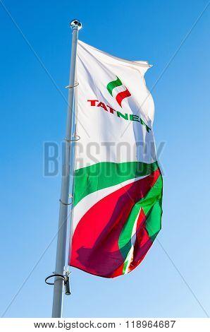 The Flag Of Oil Company Tatneft Against Blue Sky