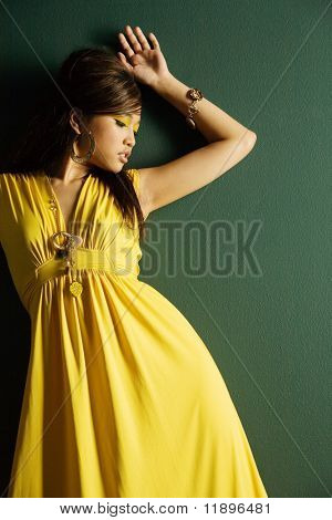 Fashionable pretty woman in yellow dress