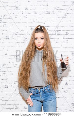 Modern Teenage Girl With Long Hair And Cola Drink