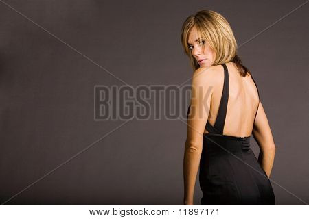 Attractive woman in black evening dress