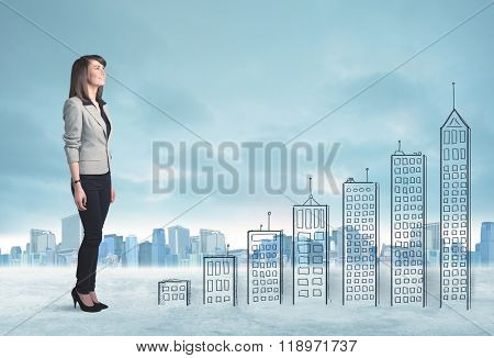 Business woman climbing up on hand drawn buildings in city concept