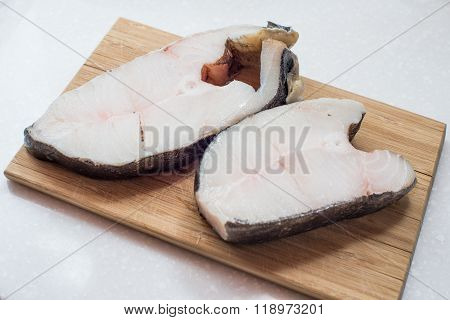 The Halibut Steak On A Chopping Board