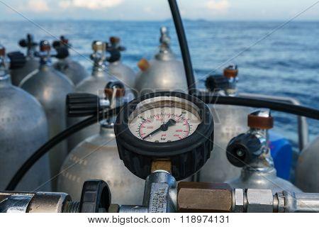 Scuba diving. Pressure meter of oxygen cylinders
