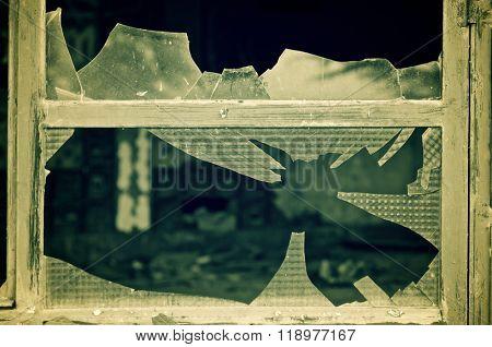 Close-up of broken windowpanes.