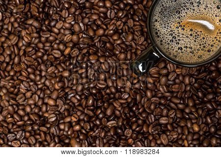 Coffee Beans Background And Black Cup With Hot Drink